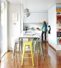 A simple backdrop of fresh white walls and warm timber floors provide the perfect canvas for colourful furnishings in the home of Jaine Fulcher.