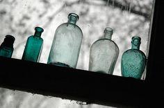 Glass Bottles on Windowsill by Metal Cowboy, via Flickr