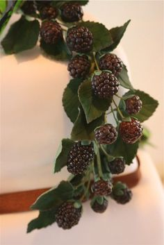 Gumpaste black berries - First attempt for black berries, they were so real, you could not tell they were made out of sugar when compared to the real thing.  I will also have the cake they were on under square wedding cakes, or check out my profile to see all the pictures. :)  Thanks for looking!