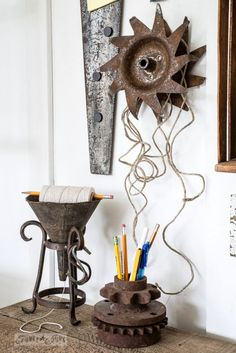 Oil funnel string dispenser, gear pen holder, cultivator wheel for twine organizing / Organize your hobby with an antique tool work station! Finally, a reason to get those tools back to work! By Funky Junk Interiors for Ebay