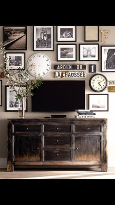 this vintage chest is so very beautiful & embellished with other vintage pieces & black & white framed photos....the techie stuff blends without intrusion into this vignette.  Hurray!!!