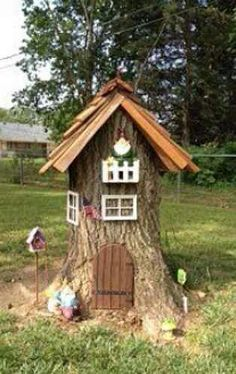 Little gnome or fairy hut made out of a tree stump. Adorable!!