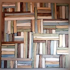wood scrap into wall hanging-almost looks like books-