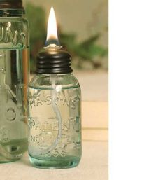 """This tiny oil lamp measures 1½"""" dia. and 4"""" tall. Includes the jar, lid and the wick and glass wick assembly. Lamp oil is not included."""