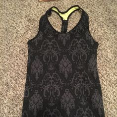 Cute yoga work out top Yoga fitted stretchy medium too. It's just too tight for my comfort. Built on bra. Tops Tank Tops