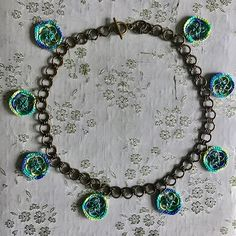 """""""Sweet greens and blues are the colors I choose...""""  #mixedmediajewelry #crochetnecklace"""