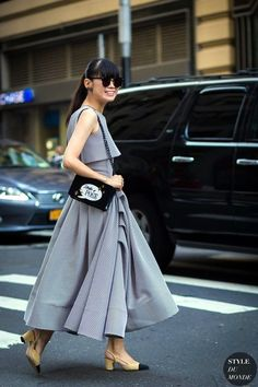 A stylish asymmetrical draped dress with sling back heels    For more style inspiration visit 40plusstyle.com