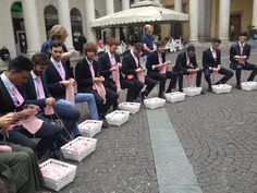 Men knitting in the center of Milan... (a sort of flashmob to support a campaign raising funds to fight breast cancer).