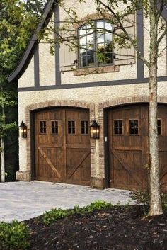 Carriage style garage doors. Perfect for French Country Garage, brick trimmed stucco finish, stone apron