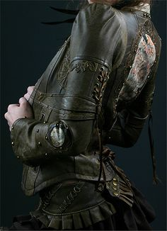 Going to make my version of this jacket. Love the lace ups on back and back of sleeves. Since I've never sewn this extensively with leather before, think I'll start with a nice brocade that's got some give to it. Think I'll stick with the olive color though...