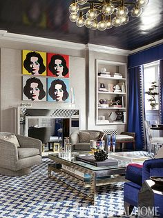 Blue is everywhere in this room! From the rug, to the velvet sofa, to the cobalt silk draperies, all the way up to the navy ceiling. - Traditional Home ®/ Photo: Peter Rymwid / Design: Jennifer Cohler Mason and Caron Pfeffer