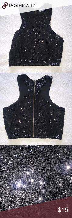 Black sequin crop top Sequin black crop top. Perfect for NYE or any night out. Pair with a pair of jeans or a skirt! Never worn. Tops