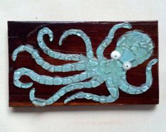 Sea glass art Octopus wall decor Sea glass mosaic octopus aqua mint on repurposed wood beach glass octopus with seashells