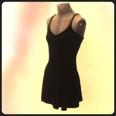 BETSEY JOHNSON VTG stretch velvet skater dress LBD Vintage 90's Classic & adorable LBD. BETSEY JOHNSON little black skater dress. Drapes beautifully! I imagine it something out of Drew Barrymore's closet!!! Equally at home with doc martens as jimmy choos. Medium. Stretchy. Divine. Fit and flare. Black label Betsey Johnson. Excellent vintage condition! Crushed velvet is 72% Acetate, 19 % nylon 9% Lycra  note: Price firm. Will keep this iconic piece happily. Betsey Johnson Dresses Mini