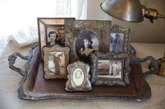 Old trays put to use...I love how the tray helps to frame the frames themselves. It really makes regular photos stand out this way.