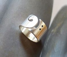 Unique metalwork ring from Sterling silver.  This ring is my own design. I sawed a bass clef symbol into a Sterling silver sheet. Sanded and polished to satin finish. Hallmarked.  Ring size: please select your size. Width: 12 mm  Each ring is individually handmade by me, you will receive a very similar ring, but not the same.   I send this item with FedEx, so you will receive it in 1-3 days. (You will receive it in a gift box, ready to give as a present.) Please convo me your phone number…