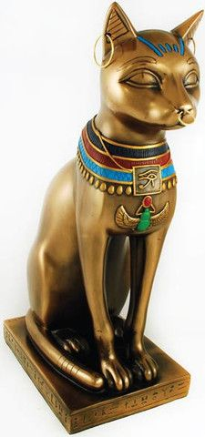 Bastet, the feline goddess of Ancient Egypt, is beloved as a protector and mother. Within the Egyptian pantheon she is the fierce protector of the two kingdoms, shown often as a lion. Bastet was also revered as a motherly goddess, and often depicted alongside her kittens. In Egyptian culture, Cats were highly revered, and a families often had them mummified when they passed, with those of wealth even decorating their cats in gold jewelry and jewels. Here Bastet is shown as a royal feli…