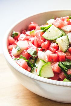 Refreshing watermelon salsa with peaches, cucumbers, cilantro, and lime.
