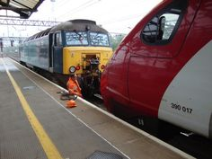 Saturday Holyhead drag of Pendolino 390017 by 57 315 as they are connected together at Crewe station on 6.5.2012