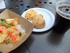 Mocequa de Pescado (Tilapia with Coconut Lime Sauce), Pao de Queijo (Cheese Bread) and a Xingu Black Beer from Brazil booth at Epcot Food & Wine 2014