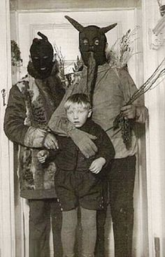 Vintage Halloween costumes. Look like a Krampus pic to me.
