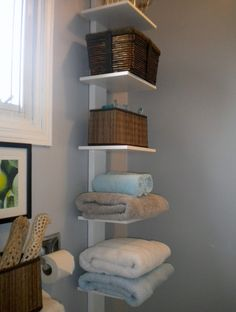 Another idea for vertical shelving in a small bathroom.