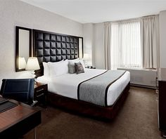 All 155 rooms at the DISTRIKT HOTEL OF NEW YORK CITY are outfitted with 500-threat-count sheets, hypoallergenic pillows (2 soft, 2 firm), leather headboards, and Simmons BeautyRest mattresses. (About three hundred twenty-five dollars per night)