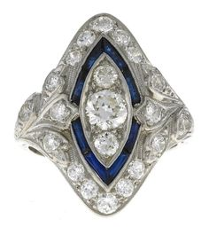 A diamond and synthetic sapphire ring  estimated total diamond weight: 1.15 carats; mounted in platinum. Art Deco or Art Deco style.