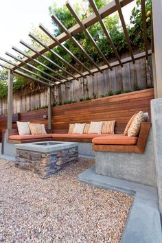 HGTV shows you a contemporary backyard seating area with built-in benches and a custom fire pit.