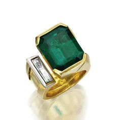 GOLD, EMERALD AND DIAMOND RING. Set with an emerald-cut emerald weighing 15.77 carats, accented by a modified baguette diamond weighing approximately 1.10 carats, size 9.