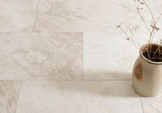 A delicate blend of cream, taupe and pale grey, with beautiful mottling and quartz detail throughout. An economy grade of marble
