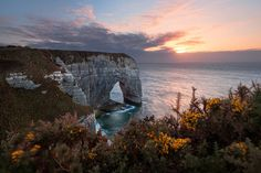Picturesque sunset over limestone arch in Manneport, Etretat