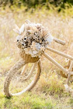 This lovely old bike has been transformed with beautiful burlap ribbons and flowers. Perfect for photography or front porch displays.
