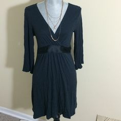 Express Black Dress. Good condition. Built in belt that ties in the back. Very soft. 100% rayon. Trim: 95% polyester, 5% spandex. Hand washable. Express Dresses Midi