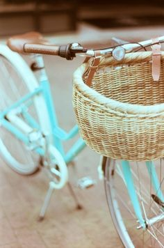 Tiffany blue bicycle. European style with the lower middle bar to easily step over and a basket to hold the shopping.