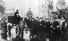 Warsaw, Poland, Jews pulling a wagon upon which German soldiers are sitting.