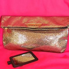 Victoria's Secret Gold Bling Clutch Bag Never used Victoria's Secret Bling gold clutch bag. Can be used in many ways and is spacious enough to hold all of your items. Bag folds over to be used as a clutch. Originally $75 . Tags still attached . Victoria's Secret Bags Clutches & Wristlets