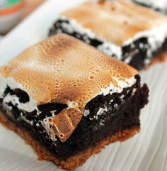 Chocolately brownies sandwiched between a graham cracker crust and delicious marshmallow frosting.