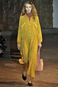 corduroy, oversized yellow jumpsuit.