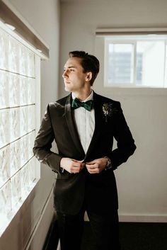 Elegant groom style with a classic black suit evergreen boutonniere and emerald green bow tie Black Suit Bow Tie, Green Bow Tie, Black Tux, Black Suits, Green Shirt, Groom Outfit, Groom Attire, Groom And Groomsmen, Groom Suspenders