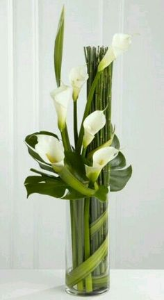 The FTD® Eternal Friendship™ Arrangement is an outstanding way to express your deepest sympathies for their loss. Sophisticated white calla lilies are skillfully arranged amongst a collection of exqui Contemporary Flower Arrangements, White Flower Arrangements, Vase Arrangements, Centerpieces, Creative Flower Arrangements, Centerpiece Wedding, Wedding Arrangements, Wedding Decor, Lys Calla