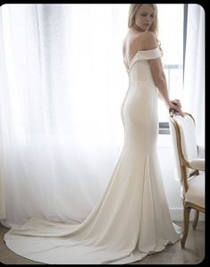 Wedding Gown Sleek and chic off-the-shoulder crepe wedding dress Wedding Dress Bustle, Crepe Wedding Dress, Sheath Wedding Gown, Wedding Fabric, Classic Wedding Dress, Sexy Wedding Dresses, Perfect Wedding Dress, Wedding Dress Styles, Bridal Dresses