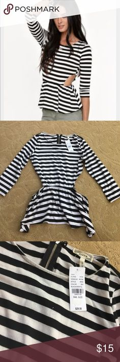Black and White stripped cut out shirt NWT- PAC Sun , Quarter sleeve , cut out on hips, size small, never worn, comfortable fit , brand new, flattering top.!! Kirra Tops Tees - Long Sleeve