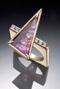 Ring | Alex Horst.  Amethyst set in a lost-wax cast 14k gold setting with channel set tanzanite gemstones