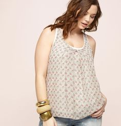 c6c8d1db05f Be feminine and be free in pretty prints like this plus size Layered Floral  Tank available