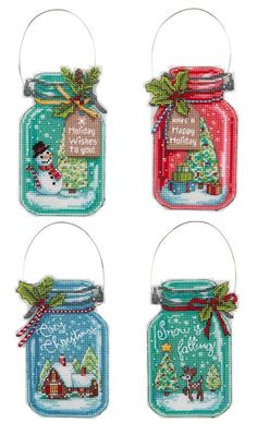 Old-fashioned mason jars are transformed into festive snow globes! Counted cross-stitch kit for a set of four 3