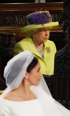The Queen shines brightly in yellow as she attends the royal wedding | Daily Mail Online