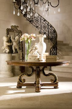 An entry furnished by Ebanista. I would be fine in this style in a very old hacienda down in Colonial Mexico.