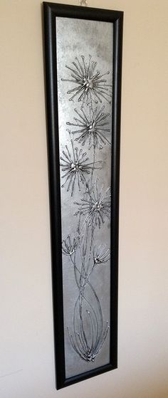 Glue Gun Art - spray painted in silver and given the distressed metal look with black acrylic paint.