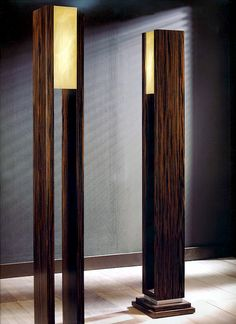 Grand scale Macassar ebony wood floor lamps or lighting torches. These large scales Macassar lamps are detailed in silver leaf or gold leaf with light shade in wonderful alabaster.